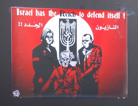 Inverting the Holocaust. A placard depicting Tzipi Livni, Ehud Olmert and Ehud Barak as Nazis at an anti-Israel rally in Boston, 2009 (photo credit: CC BY dvanhorn, Flickr)