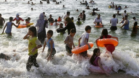 Palestinians enjoy the beach in Rafah, the southern Gaza Strip, June 2012 (photo credit: Abed Rahim Khatib/Flash 90)