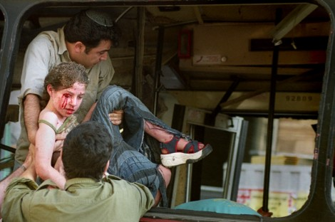 Rescue personnel remove a wounded girl from the wreckage of bus 14A in Jerusalem, June 11, 2003 (photo credit: Flash90)