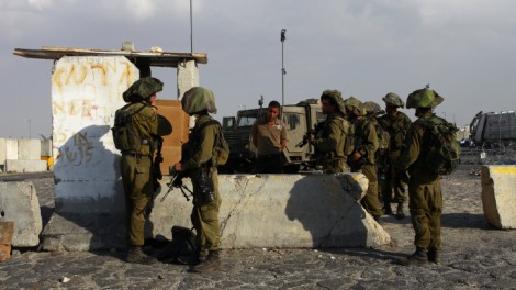 IDF soldiers at the Qalandia checkpoint (photo credit: Nati Shohat/Flash90)