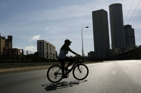 My way on the highway. A woman rides a bicycle down the entirely deserted Ayalon freeway, on a regular day Tel Aviv's main traffic artery, Yom Kippur 2008 (photo credit: Miriam Alster/Flash90)