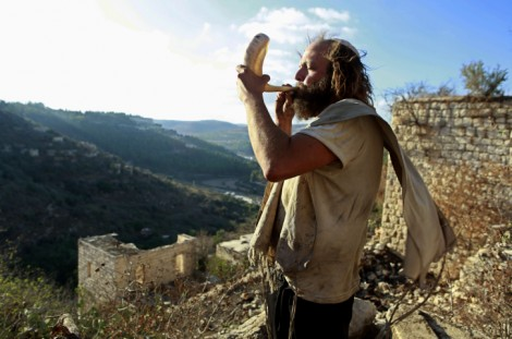 Who will live and who will die? Blowing the shofar in Lifta, near Jerusalem (pho