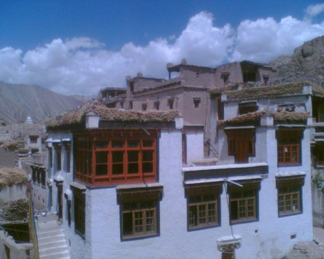 Typical Ladakhi home built of mud bricks and stone, then whitewashed, in the village of Alchi (photo credit: Gavin Gross)