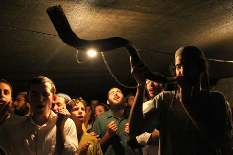 Radical times. Jewish worshipers blow the shofar and pray in the Judean Desert ahead of Rosh Hashanah (photo credit: Nati Shohat/Flash90)