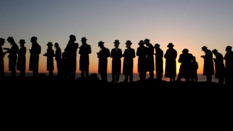 'For men, the black hat is most conspicuous and easiest to perch on a cynical head.' Ultra-Orthodox Jewish men of the Vizhnitz Hassidic sect perform the Rosh Hashanah Tashlih ceremony on the coast of Herzliya, September 2012 (photo credit: Roni Schutzer/Flash90)