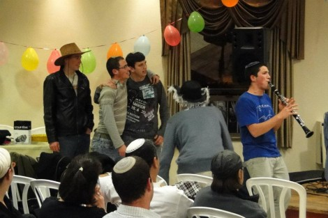 Elyashiv Luvitz z&quot;l, far right, entertaining the community just this past Purim