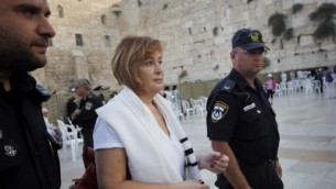 Police detain Lesley Sachs, the director of Women of the Wall, for wearing a prayer shawl, Wednesday (photo credit: Miriam Alster/Flash90)