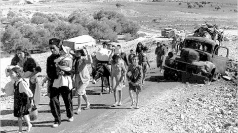 Palestinian refugees making their way from the Galilee in 1948, after following the establishment of Israel (photo credit: Fred Csasznik/public domain)