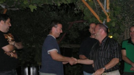 This is a picture of me shaking hands with Yotam at my discharge party in 2004. (photo credit: courtesy Plugat Lotan/Gdud 294 website)
