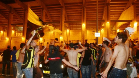 Betar Jerusalem supporters celebrate and dance outside Jerusalem's Teddy Stadium (photo credit: Orel Cohen/Flash90)