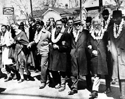 Martin Luther King Jr. and Rabbi Abraham Joshua Heschel marching from Selma, Ala., to Montgomery, Ala., 1965
