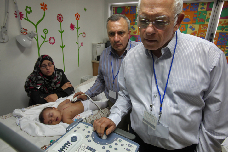 Will Hamas jail families of children treated by Israeli doctors? Pictured: Pediatric cardiologists at Wolfson Medical Center providing care through the 'Save a Child's Heart' foundation (photo: David Silverman / Flash 90)