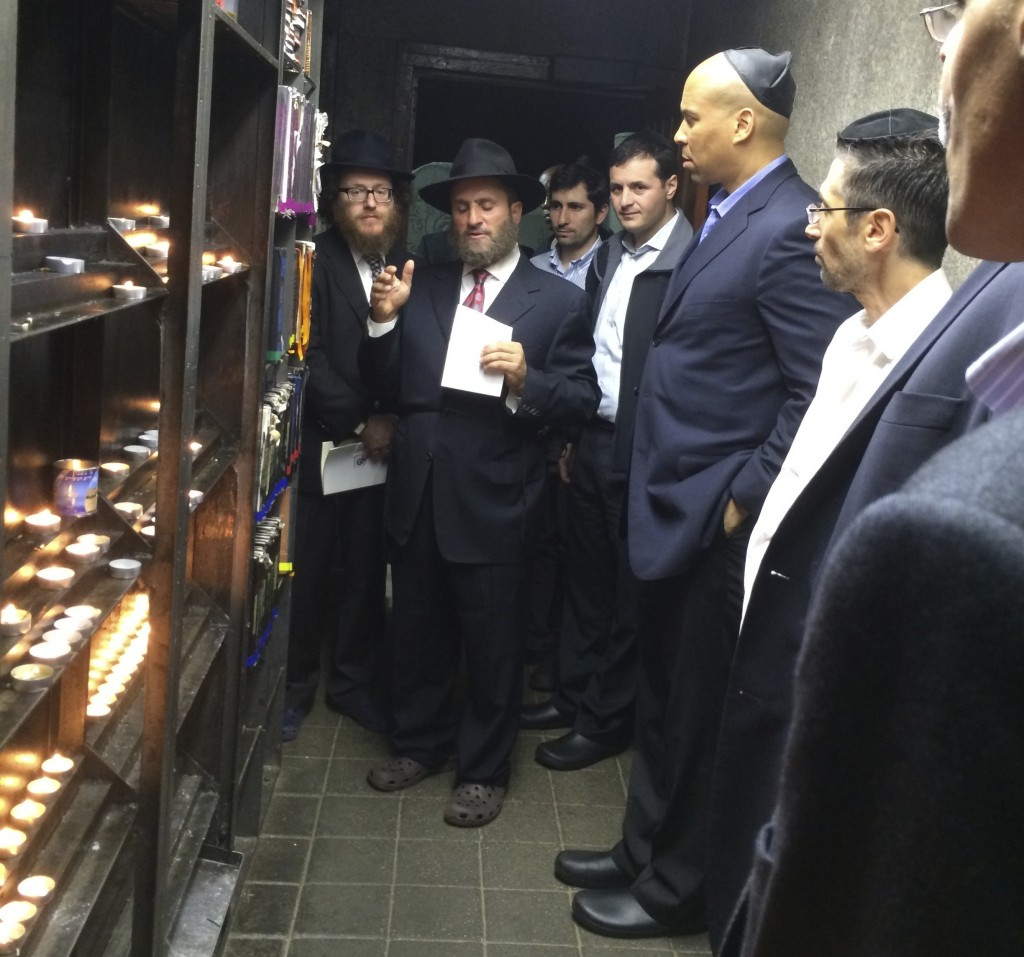Rabbi Shmuley Boteach praying with Senator-elect Cory Booker  at the Grave of the Lubavitcher Rebbe last week. (Photo: Courtesy Shmuley Boteach)