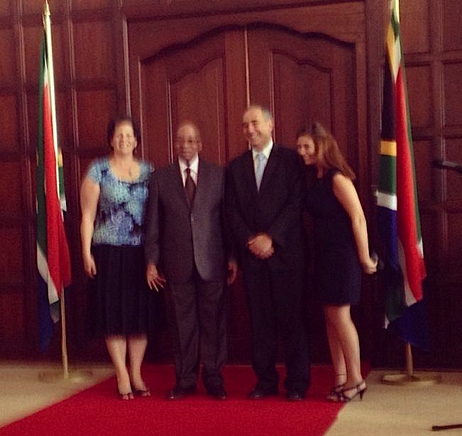 A fuzzy cellphone photo of the Lenks with President Zuma. Photographer and daughter Ilana is on the right.