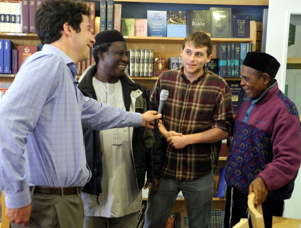 (Left to right) David Micley  interviews Elder Pinchas Ogbukaa, Gabe Fine, and Elder Ovadia Agbai in Boston, Massachusetts (Photo credit - Shai Afsai)
