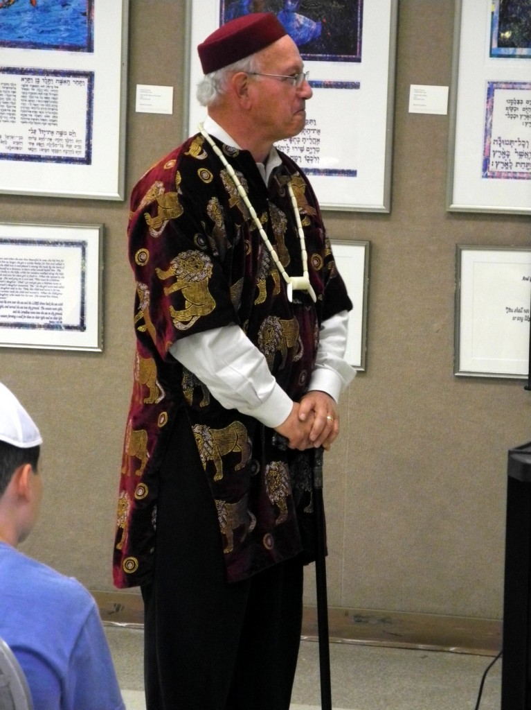 Rabbi Wayne Franklin, in Nigerian garb, listens to the elders talk to students at Temple Emanu-El's Relgious School in Providence ( Photo credit - Shai Afsai)
