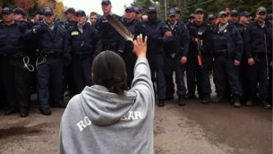 Native American women warriors are risking everything to protect the water, the land, and the future generations - for all of us. This image of Amanda Polchies at a Mi'kmaq protest against potential fracking near Elsipogtog First Nation in New Brunswick, Canada, taken by reporter Ossie Michelin, went viral.