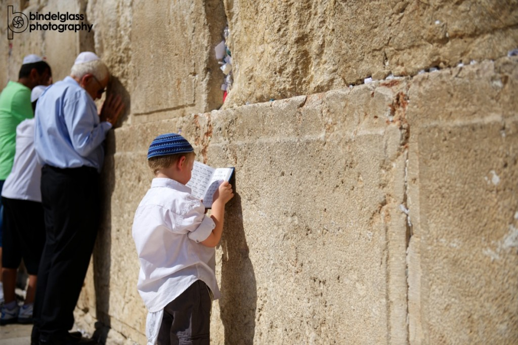 A child prays at the Kotel. Photo by Perry Bindelglass