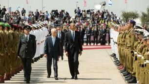 President Barack Obama and Israeli President Shimon Peres inspect an honor guard during the official arrival ceremony at Ben Gurion International Airport in Tel Aviv