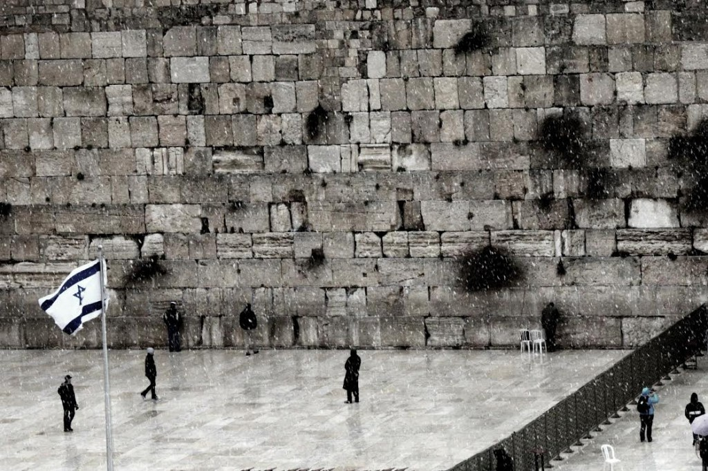 Snow falls on the Kotel. Photo by Nechama Perton