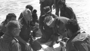 Former chief of staff Haim Bar-Lev, center left, consults with Maj. Gen. Ariel Sharon (with bandage) and Moshe Dayan, center, during the Yom Kippur War. (photo credit: GPO/Flash90)