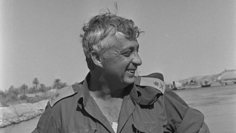 Ariel Sharon stands at the Suez Canal during the Yom Kippur War.