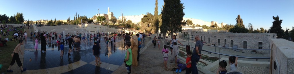 Old and new - Kids play in the Teddy Fountains just outside of the Old City. Photo by Brian John Thomas