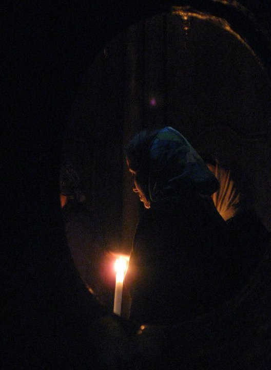 A Christian pilgrim prays at the Church of the Holy Sepulcher. Photo Yifa Yaakov