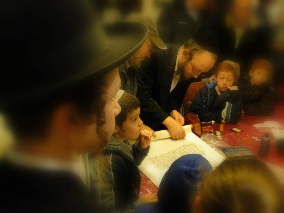 Completing a Sefer Torah. Photo by Laura Ben-David