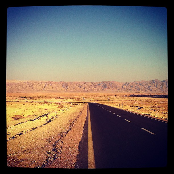 A long stretch of highway into the desert near Kibbutz Lotan. Photo by Erica Schain