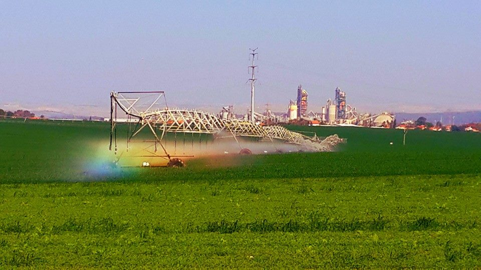 Industry and agriculture... and a rainbow in between. Photo by Daniel Seaman.