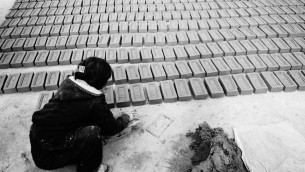 Woman making bricks by hand in factory in Kathmandu