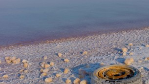 Not everyone who comes into contact with the Dead Sea respects it silent beauty. THe salt wil one day overtake this trash tire and turn it into a salt mound. Please click on picture for full frame.