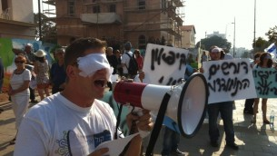 Senior 'One Voice Israel' activist Tal Harris demonstrating against Israeli government's 'blind' settlement policies