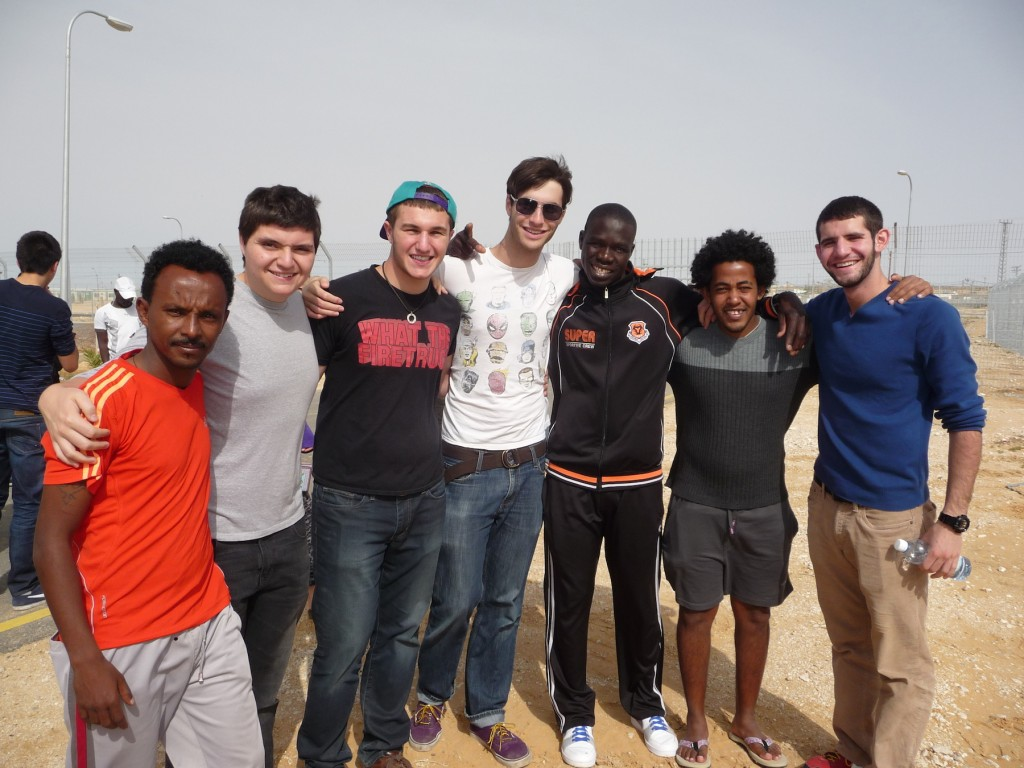 KIVUNIM participants meet asylum seekers at the Holot detention facility. (Photo: Courtesy of KIVUNIM)