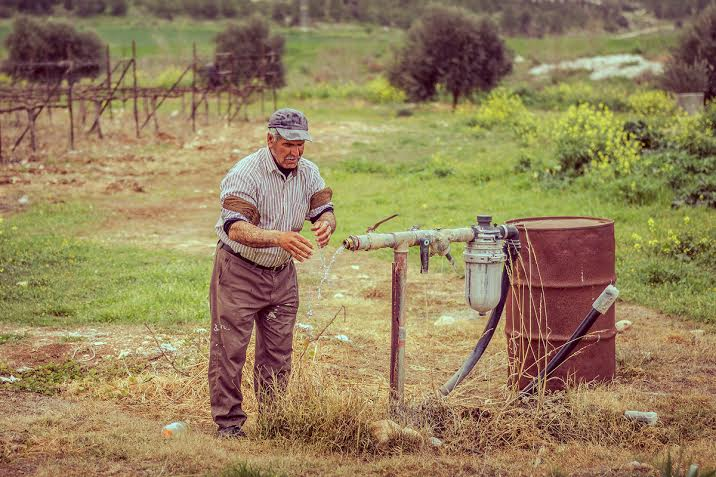 Working the land. Photo by Yehoshua Derovan