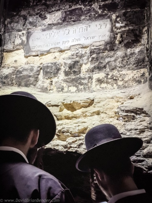 Jewish worshipers at the underground tomb of Mishnaic-era scholar, R' Yehuda Bar Ilai, near Safed, Israel.