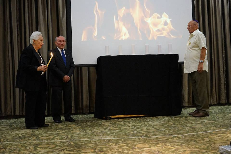 Holocaust survivor Mrs. Renee Firestone lights the memorial candle-Photo Orly Halevy