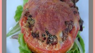 Tomatoes Stuffed with  Sausage and Basil in a Tomato Basil Sauce