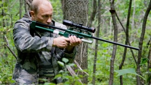 Russian leader Vladimir Putin on the hunt for the Amur tiger.