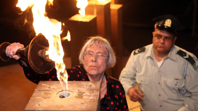 Former Supreme Court justice Dalia Dorner light a torch during a ceremony at Kibbutz Tel Yitzhak, as Israel marks the annual Holocaust Remembrance Day on April 27, 2014. (photo credit: Gideon Markowicz/Flash90)