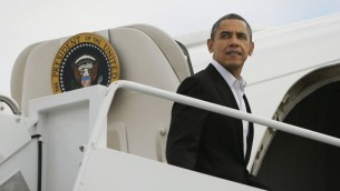 US President Barack Obama boards Air Force One at Andrews Air Force Base in Maryland in November 2012  (photo credit: AP/Pablo Martinez Monsivais)