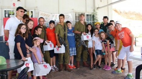 A bar mitzvah boy from Brazil and his family with IDF soldiers at the Pina Chama. Photo credit: Laura Ben-David