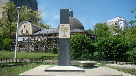 The Iasi Pogrom Memorial, With The Great Synagogue of Jassy in the background. Courtesy Milad Doroudian, 2013