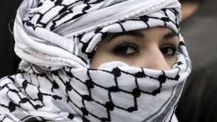 Woman wearing Keffiyeh (photo credit: CC BY-SA 2.0, Jean-François Gornet, wikipedia.org)