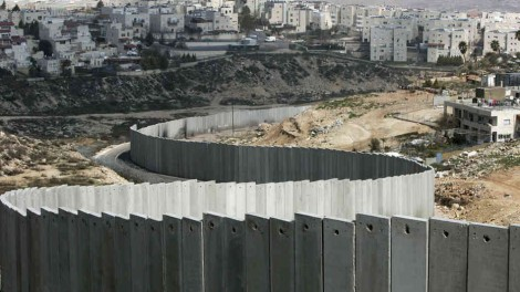 Israel's separation barrier is seen along the east Jerusalem neighborhood of Ras Khamis on March 4, 2009.  AFP/Getty Images
