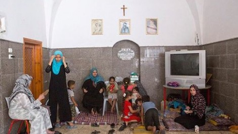 Palestinians find refuge inside central Gaza City's Church of St. Porphyrius, July 22, 2014. PHOTO: Anne Paq/Activestills.org