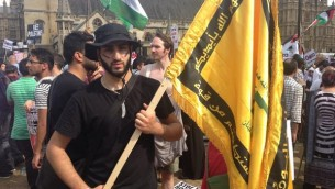 When playing pretend isn't funny: Dressed in black, complete with camouflage make-up, this man is imitating Hezbollah.