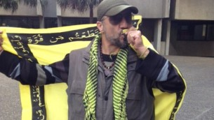 A protestor named as Mahdi Nasseri, kisses a pro-Hezbollah banner in Sydney, Australia. 13th July 2014