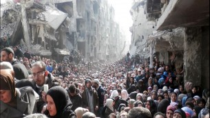 Yarmouk, near Damascus, Syria: Palestinians queuing to receive food aid, during one of the rare occasions that such aid was able to reach them.